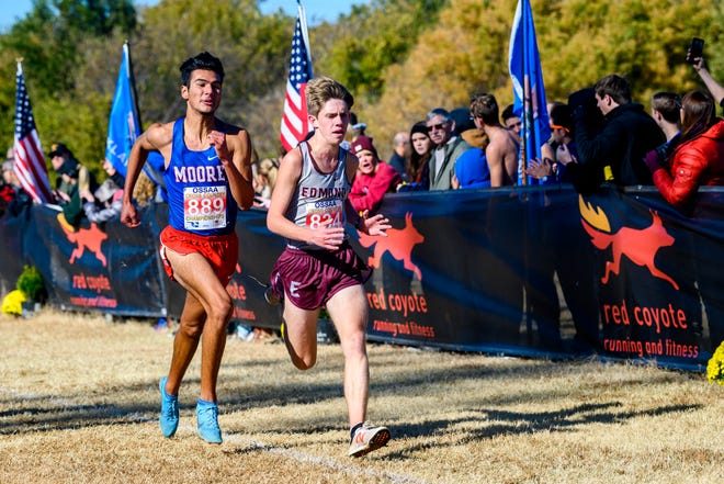 Moore's Carlos Soto, left, and Edmond Memorial's Simon Larrimore approach the finish line during the Class 6A state race at Edmond Santa Fe on Nov. 2, 2019. [KT King/For The Oklahoman]