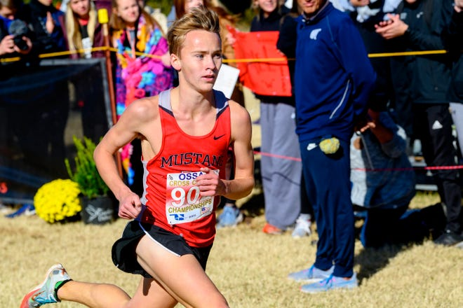 Mustang's Gabe Simonsen sprints to the finish line during the Class 6A cross country state meet at Edmond Santa Fe on Nov. 2, 2019. [KT King/For The Oklahoman]
