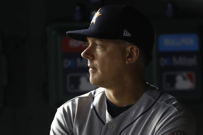 Houston Astros manager AJ Hinch watches during the second inning of Game 5 of the baseball World Series against the Washington Nationals Sunday, Oct. 27, 2019, in Washington. (AP Photo/Patrick Semansky)