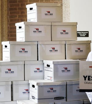 Boxes of petitions for state question 802 are stacked before being delivered to the Oklahoma Secretary of State's office in Oklahoma City, Thursday, Oct. 24, 2019. [Nate Billings/The Oklahoman]