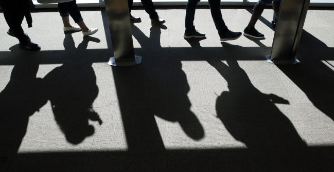 Air travelers cast shadows while boarding at Will Rogers World Airport last year. About half as many travelers are expected to pass through the airport during the Thanksgiving holiday this year. [THE OKLAHOMAN ARCHIVES]
