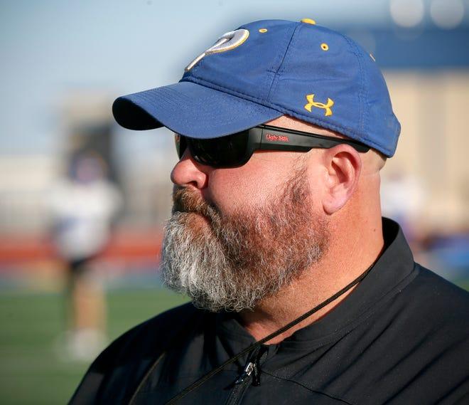 Piedmont head coach Jeff Hall watches his team practice at the Piedmont High School football stadium in Piedmont, Okla., Tuesday, Nov. 26, 2019. [Nate Billings/The Oklahoman]
