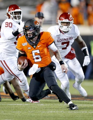 Oklahoma State's Dru Brown (6) rushes in the third quarter during the Bedlam college football game between the Oklahoma State Cowboys (OSU) and Oklahoma Sooners (OU) at Boone Pickens Stadium in Stillwater, Okla., Saturday, Nov. 30, 2019. OU won 34-16. [Sarah Phipps/The Oklahoman]