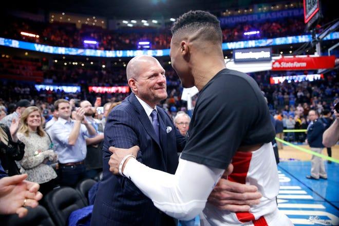 Houston's Russell Westbrook (0) hugs Clay Bennett following the NBA basketball game between the Oklahoma City Thunder and the Houston Rockets at the Chesapeake Energy Arena in Oklahoma City, Thursday, Jan. 9, 2020. [Sarah Phipps/The Oklahoman]