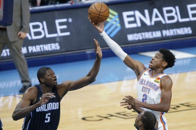 Oklahoma City's Shai Gilgeous-Alexander (2) goes to the basket beside Orlando's Mo Bamba (5) during a game in November 2019 at Chesapeake Energy Arena. [Bryan Terry/The Oklahoman]