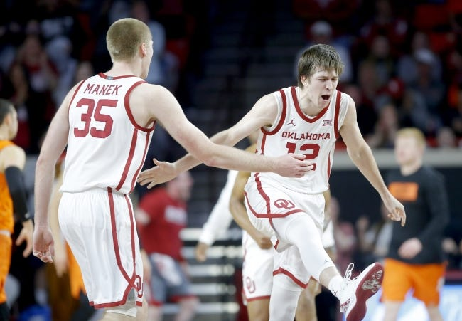 Oklahoma's Austin Reaves, right, celebrates with Brady Manek against Oklahoma State last season. Reaves and Manek are back as the team's leaders this season, which begins with practice Wednesday. [Bryan Terry/The Oklahoman]