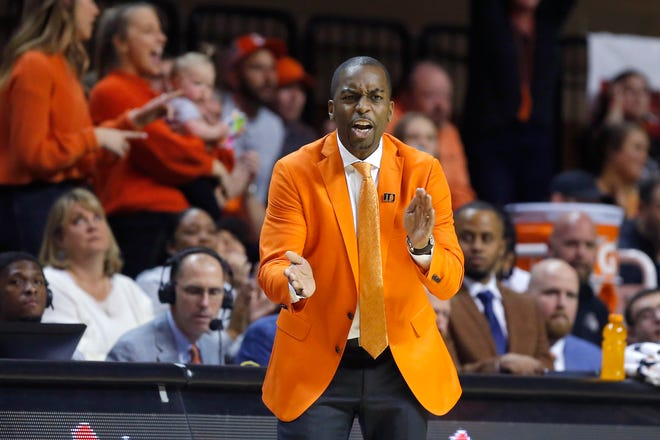 Oklahoma State coach Mike Boynton claps during an NCAA men's Bedlam basketball game between the Oklahoma State University Cowboys (OSU) and the University of Oklahoma Sooners (OU) at Gallagher-Iba Arena in Stillwater, Okla., Saturday, Feb. 22, 2020. Oklahoma State won 83-66. [Bryan Terry/The Oklahoman]