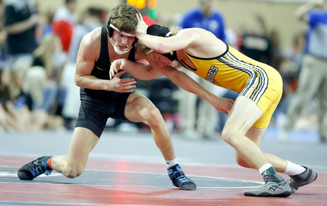 Stillwater's Cade Nicholas, left, wrestles Sand Springs' Seth Jones in the Class 6A 126-pound semifinal match at the state tournament at State Fair Arena on Feb. 28, 2020. [Bryan Terry/The Oklahoman]
