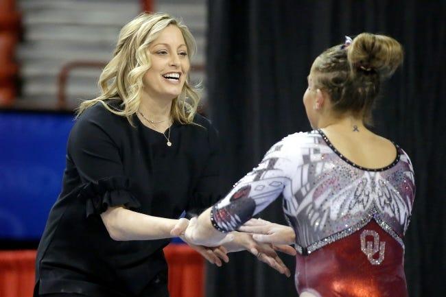 Oklahoma coach K.J. Kindler greets Olivia Trautman after Trautman's balance beam performance during the Perfect 10 gymnastics meet last season in Oklahoma City. [Bryan Terry/The Oklahoman]