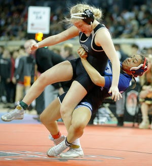 Guthrie's Khaleah Kirk, right, wrestles Broken Arrow's Allison Hynes in the 118-pound championship match during the state tournament at State Fair Arena on Feb. 29, 2020. The Oklahoma Secondary School Activities Association did not officially sanction the girls state tournament last year. This season's state tournament will be officially recognized. [Bryan Terry/The Oklahoman]