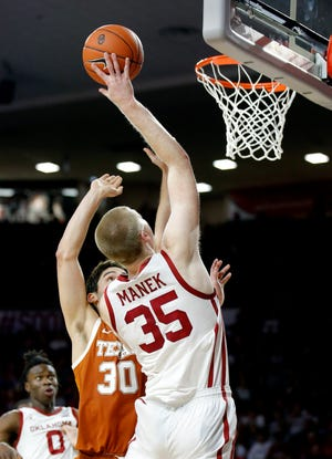 Oklahoma's Brady Manek (35) goes to the basket against Texas last season. Manek and the Sooners will open their season Nov. 25 against Texas-San Antonio. [Sarah Phipps/The Oklahoman]