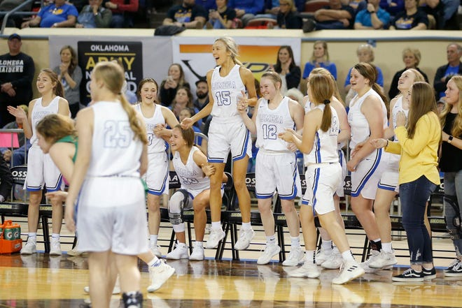 """Lomega celebrates after wining the Class B girls state basketball tournament championship game between Lomega and Varnum inside Jim Norick Arena, """"The Big House,"""" at the OKC Fairgrounds in Oklahoma City, Saturday, March 7, 2020. [Bryan Terry/The Oklahoman]"""
