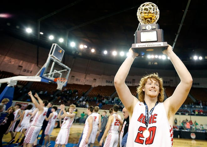 "Duke's Jameson Richardson (20) celebrates with the trophy following the Class B boys basketball tournament championship game between Duke and Leedey inside Jim Norick Arena, ""The Big House,"" at the OKC Fairgrounds in Oklahoma City, Saturday, March 7, 2020. [Sarah Phipps/The Oklahoman]"