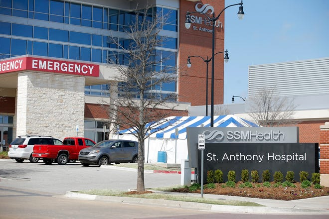 An exterior photo of the emergency room entrance at SSM Health St. Anthony Hospital in Oklahoma City, Wednesday, March 18, 2020. [Bryan Terry/The Oklahoman]