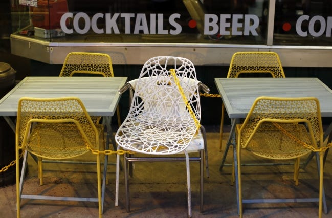 A state order requires bars and restaurants to stop serving at 11 p.m., but some businesses and individuals are challenging Oklahoma City's enforcement of that rule. [Oklahoman Archive Photo]