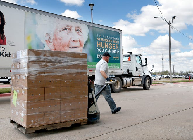 Glynn Walker with the Regional Food Bank delivers food to the OKCPS Operations Center in Oklahoma City, Tuesday, March 31, 2020. [Sarah Phipps/The Oklahoman]