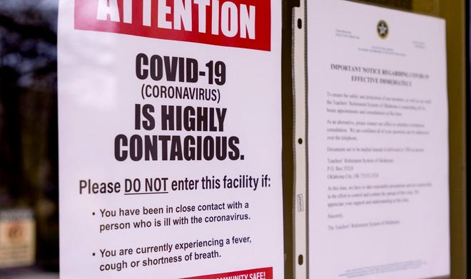 Signs that are posted about the Coronavirus on the doors of the Oklahoma State Department of Education in Oklahoma City, Okla. on Monday, March 16, 2020. Oklahoma's State Superintendent of Public Instruction, Joy Hofmeister announced the closing of public school till April 6 to combat the spread of the Coronavirus. [Chris Landsberger/The Oklahoman]