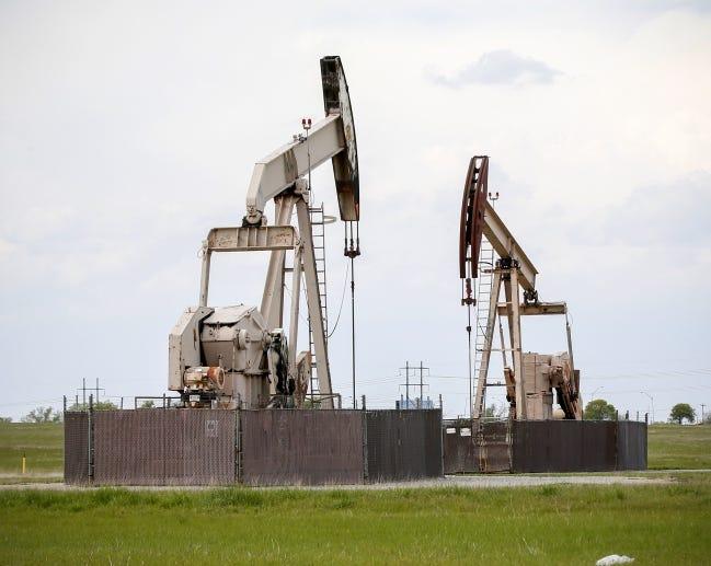 Pump jacks produce oil from wells in an Oklahoma City-area field. [THE OKLAHOMAN ARCHIVES]