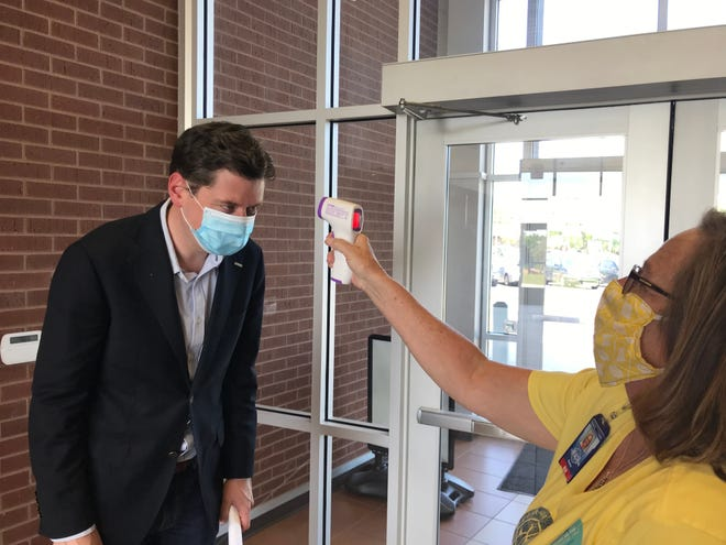 Oklahoma City Mayor David Holt had his temperature taken before a COVID-19 press briefing earlier this year. Personal responsibility is a must as cases surge, he says. [The Oklahoman Archive]
