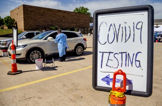 Canadian County Health Department employees collect samples from a drivers during the Canadian County Health Department's Covid-19 drive thru Testing Event at Yukon Middle School on Wednesday, May 6, 2020, in Yukon, Okla. [Chris Landsberger/The Oklahoman]