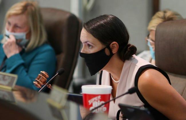 Norman mayor Breea Clark bangs her gavel to quiet the crowd during a June City Council meeting. [Doug Hoke/The Oklahoman]
