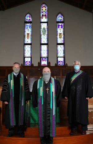 In this July 2020 photo, the Rev. Sam Powers, the Rev. Trey Witzel and the Rev. Don Vaught wear masks as they pose for a picture in the sanctuary of First United Methodist Church of Edmond, where Powers is senior minister. [Doug Hoke/The Oklahoman Archives]