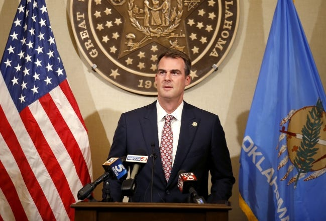 Gov. Kevin Stitt is pictured speaking at a news conference. Photo by Sarah Phipps, The Oklahoman