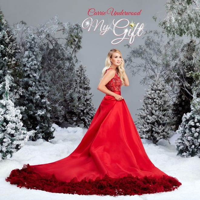 """Carrie Underwood's first Christmas album, titled """"My Gift,"""" has topped multiple Billboard charts. [Album cover photographed by Joseph Llanes]"""