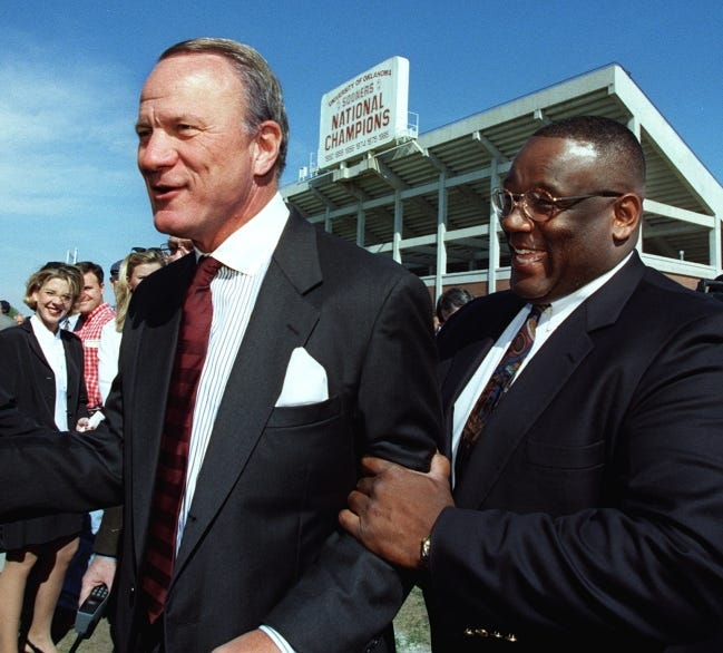 """Former OU defensive lineman and head coach John Blake, right, is one of at least nine former Sooners to play for coach Barry Switzer, left, who died in 2020. """"When you recruit 'em, you have 'em for life,"""" Switzer said. """"It's too many this year."""" [OKLAHOMAN ARCHIVES]"""