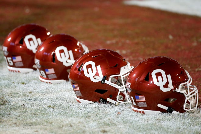 Helmets sit on the field before an NCAA football game between the University of Oklahoma Sooners (OU) and the TCU Horned Frogs at Gaylord Family-Oklahoma Memorial Stadium in Norman, Okla., Saturday, Nov. 23, 2019. Oklahoma won 28-24. [Bryan Terry/The Oklahoman]