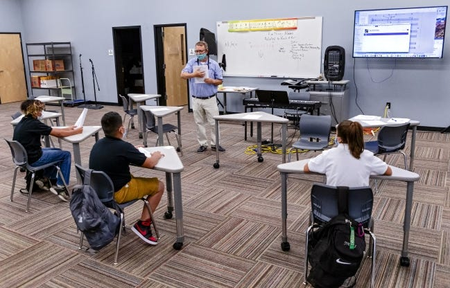Mark Johnson works with students in August in a reduced-size choir class at Santa Fe South High School. The Oklahoma State Board of Education agreed Thursday not to issue letter grades for school performance for the 2020-21 school year. [Chris Landsberger/The Oklahoman]