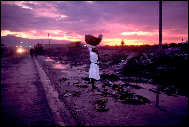 """Peter Turnley's (American, born 1955) 1994 image """"Near Cité Soleil, Port-au-Prince, Haiti"""" is featured in the exhibit """"Shared Lives, Distant Places: Recent Acquisitions in Photography"""" at the Oklahoma City Museum of Art. [Photo provided]"""