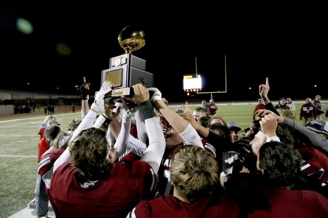Shattuck celebrates with the trophy after winning the Class B state championship game against Tulsa Regent Prep last December at Western Heights High School. [Bryan Terry/The Oklahoman]