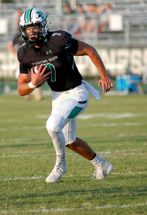 McGuinness's Luke Tarman rushes during the high school football game between McGuinness and Muskogee at Bishop McGuinness High School in Oklahoma City, Friday, Aug. 28, 2020. Photo by Sarah Phipps, The Oklahoman