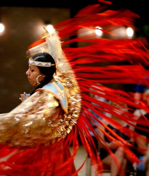 Courtney Reeder, who is Kiowa and Creek, performs a fancy shawl dance during a dance exhibition by the Central Plains Dancers at the Red Earth Festival at Grand Event Center at the Grand Casino Hotel & Resort, Saturday, Sept. 5, 2020. [Bryan Terry/The Oklahoman Archives]
