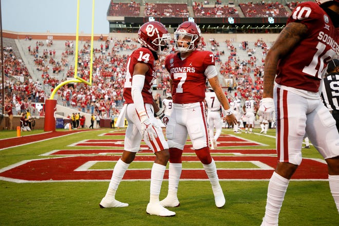 Oklahoma Sooners wide receiver Charleston Rambo (14) and quarterback Spencer Rattler (7) celebrate after Rambo's touchdown catch during the NCAA football game between the Oklahoma Sooners and the Missouri State Bears at Gaylord Family-Oklahoma Memorial Stadium in Norman, Okla., on Saturday, Sept. 12, 2020. IAN MAULE/Tulsa World