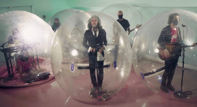 """The Flaming Lips perform """"God and the Policeman"""" on """"The Tonight Show Starring Jimmy Fallon"""" in September. [NBC photo]"""