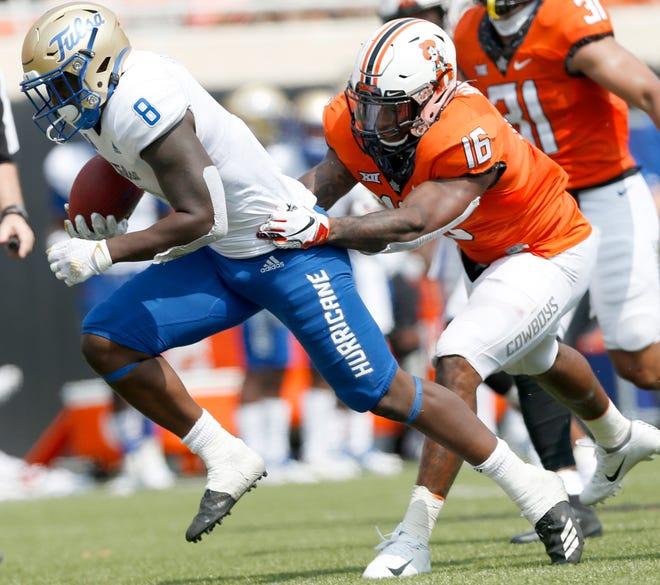 Oklahoma State's Devin Harper (16) makes a tackle against Tulsa in September. [John Clanton/Tulsa World]