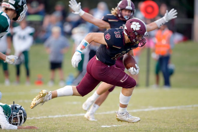 Cashion's Mason Manning scores a touchdown during a game against Thomas in Cashion on Sept. 18. [Sarah Phipps/The Oklahoman]