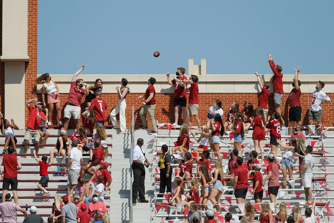 Oklahoma fans throw the football used for a Kansas State extra point over the top of the north side of the stadium during a college football game between the University of Oklahoma Sooners (OU) and the Kansas State Wildcats at Gaylord Family-Oklahoma Memorial Stadium in Norman, Okla., Saturday, Sept. 26, 2020. Kansas State won 38-35. [Bryan Terry/The Oklahoman]
