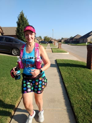 Gretchen Phelps has trained for the Memorial Marathon by running through her neighborhood. Now that will be her marathon course Sunday with family, friends and neighbors cheering her on. [PHOTO PROVIDED]
