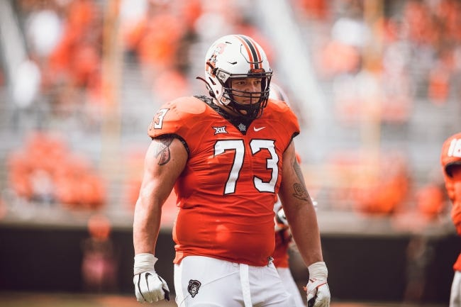 Oklahoma State offensive lineman Teven Jenkins is emerging as a potential early-round pick in the NFL Draft. [T.C. Brewster/OSU Athletics]