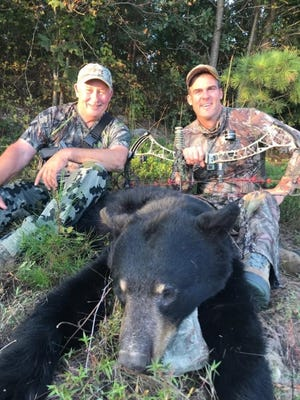 Gov. Kevin Stitt killed a black bear on the opening day of archery bear season Thursday in McCurtain County. Also pictured is Stitt's guide, Tom Cartwright of Holdenville. Archery bear season runs through Oct. 18 in southeast Oklahoma. [PHOTO VIA FACEBOOK/J.D. STRONG]