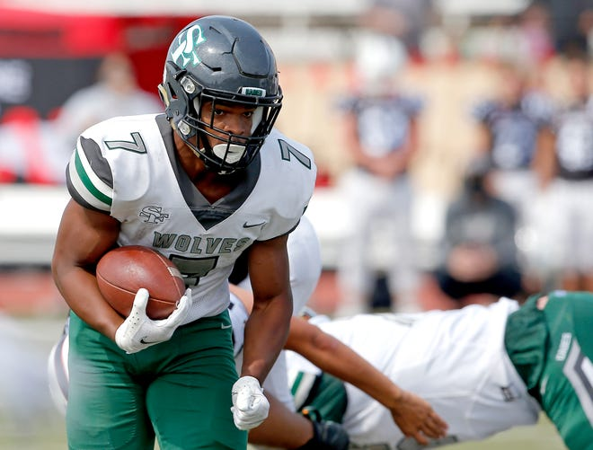 Edmond Santa Fe's Ethane Hyche runs during the high school football game between Westmoore and Edmond Santa Fe at Moore High School in Moore, Okla., Saturday, Oct. 3, 2020. Photo by Sarah Phipps, The Oklahoman