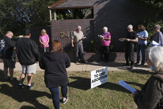 People pray the rosary during a 40 Days for Life anti-abortion prayer vigil outside Abortion Surgery Center in Norman. [Doug Hoke/The Oklahoman]