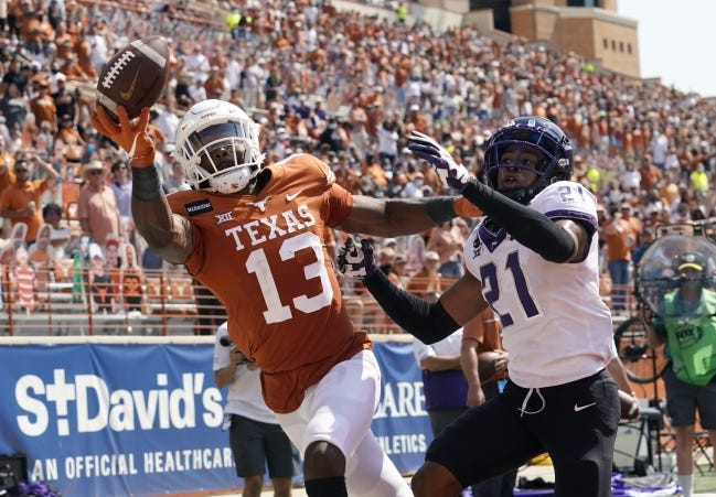 TCU cornerback Noah Daniels (21) breaks up a pass intended for Texas receiver Brennan Eagles (13) during the second half of a 33-31 win Saturday in Austin. [AP Photo/Eric Gay]