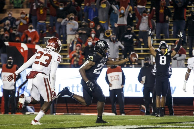 Iowa State's Breece Hall (28) runs into the end zone for the winning touchdown Saturday in a 37-30 victory against Oklahoma. [Brian Powers/USA TODAY Sports]
