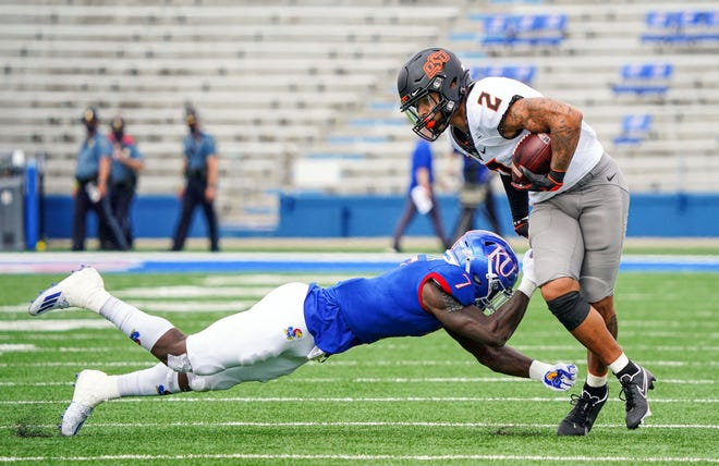 Oklahoma State's Tylan Wallace (2) had nine catches for 148 yards and two touchdowns Saturday in a 47-7 win at Kansas. [Jay Biggerstaff/USA TODAY Sports]