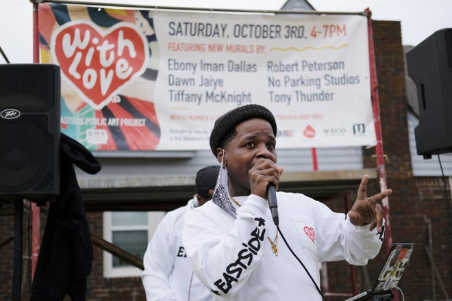 Jabee speaks at Celebration of With Love, an Eastside Public Art Project, where six local black artists painted murals Saturday on the side of The Market building at 1708 NE 23 St. The event included music and food. [Photos by Doug Hoke/The Oklahoman]