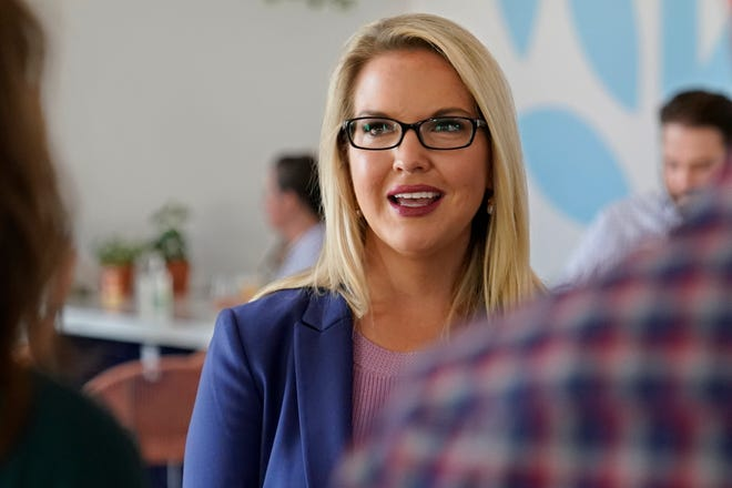 U.S. Senate candidate Abby Broyles speaks with people at a fundraiser Friday, Sept. 25, 2020, in Oklahoma City. (AP Photo/Sue Ogrocki)